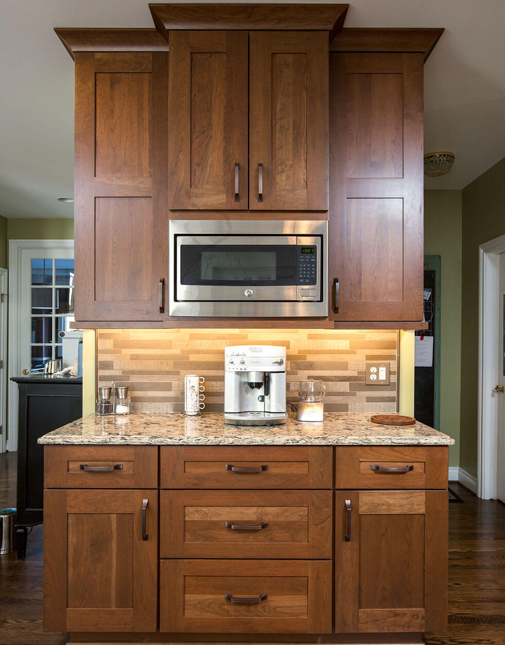 Convenient home Coffee Station with dark-stained cherry cabinetry